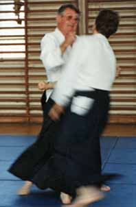 Foster Sensei at the Institute of                                 Aikido Summer School demonstrates atemi                                 during an Aikido technique.