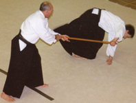 Ron Russell Sensei throwing with the Jo.